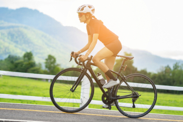 Fit woman riding a bike on the street
