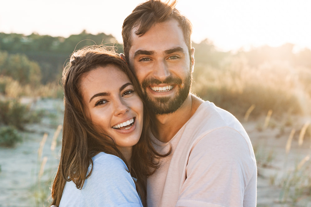 Very happy young couple holding eachother